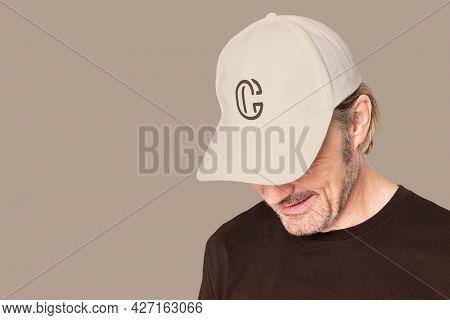 Man in beige cap with C logo for men's apparel shoot