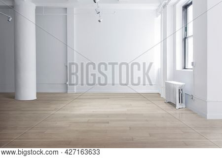 Empty minimal room with windows and natural light