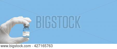 Covid Vaccine Flask Held In Hand Banner