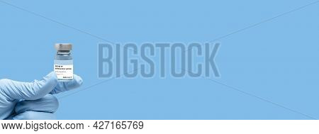 Covid Vaccine Flask Held In Hand Banner 2