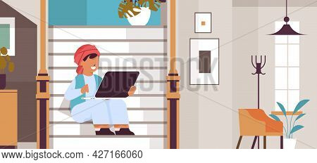 Arab Schoolboy Using Laptop Arabicc Boy Sitting On Staircase And Doing Homework Education Concept