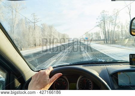 Siberia, Russia - November 28, 2020: View From Of Car Interior From Side Of Driver To The Road And N