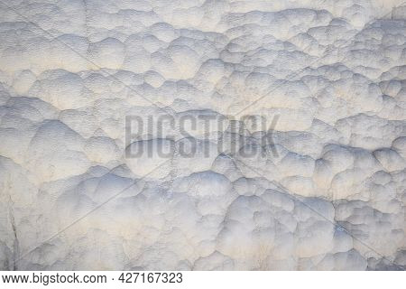 Close-up Of A Surface Covered With Deposits Of White Travertine.