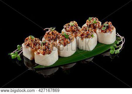 Sushi Rolls With Cream Cheese, Eel, Avocado, Daikon, Microgreen Sprouts, Unagi Sauce