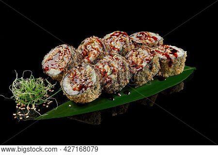 Warm Sushi Roll With Eel, Cream Cheese, Mango, Avocado In Panko With Unagi Sauce