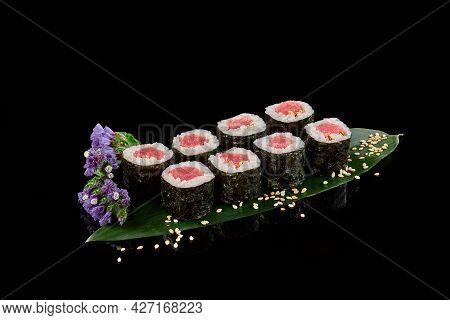 Makizushi Rolls With Tuna And Sesame On Bamboo Leaf