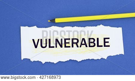 Vulnerable - Word On A Torn White Paper On A Blue Background. Info Concept