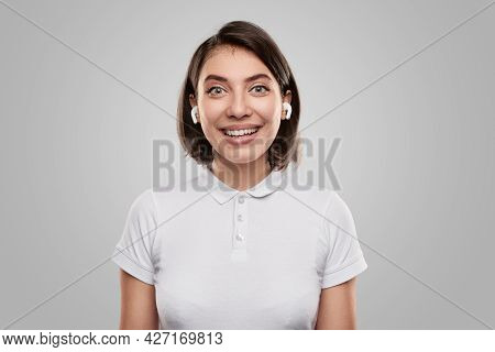 Happy Young Female In Casual Wear Looking At Camera With Astonished Face Expression While Listening