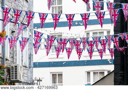British Union Jack Flag Triangular Hanging In Preparation For A Street Party. Festive Decorations Of