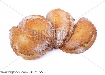 Group of cottage cheese patties isolated over white background