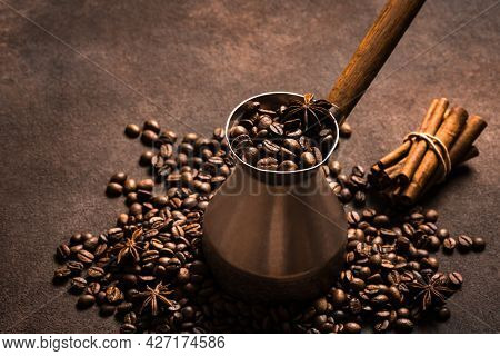 Roasted Coffee Beans, Spices And Turk (cezve). Spicy Turkish Coffee With Cinnamon And Anise Composit