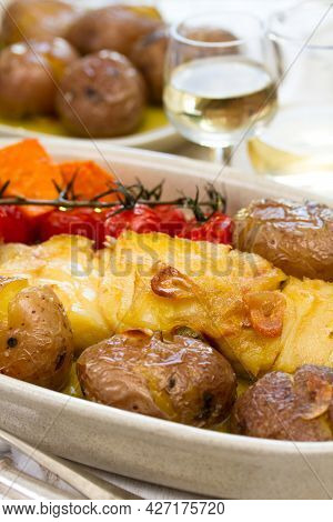Cod Fish With Potato On Dish On Wooden Background