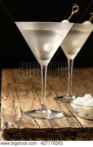 Gibson Martini Cocktail With Onions On Wooden Table
