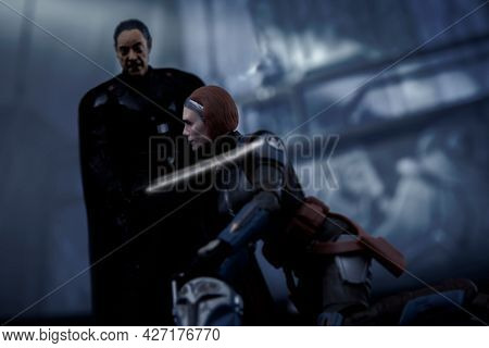 JUNE 12 2021: scene from Star Wars with Imperial Moff Gideon defeating Mandalorian Bo Katan Kryze with the Darksaber - Hasbro action figure