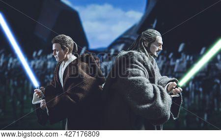 JUNE 12 2021: Star Wars Jedi Obi Wan Kenobi and Qui Gon Jinn with lightsabers - Hasbro action figure
