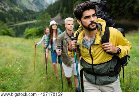 Hard, Difficult, Tiring And Exhausting Expedition Of Friends. Trekking, Outdoor, Activity Concept.