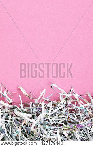 Shredded Paper On Light Pink Background. Selective Focus Image.