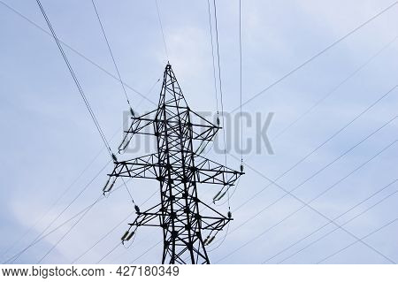 Electricity Pylon, Electrical Transmission Tower, Against Blue Sky Background. Energy Power Tower In
