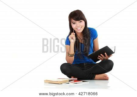 Asian Woman Sit And Writing A Book