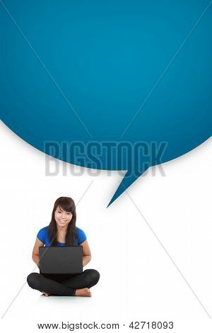 Young Casual Woman Sitting Down Smiling Holding Laptop With Box Word