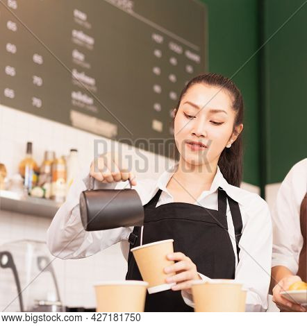 Right Side Of Takeaway Coffee Cup In Two Hands Of Customer And Beautiful Caucasian Barista Woman Who