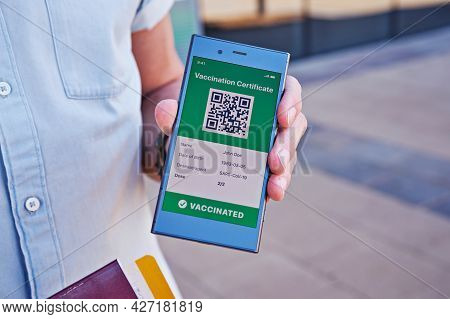 Closeup Male Hand With Smartphone Displaying On App Mobile Valid Digital Vaccination Certificate For