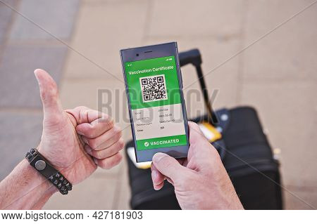 Closeup Male Hand With Smartphone Display On App Mobile Displaying Valid Digital Vaccination Certifi