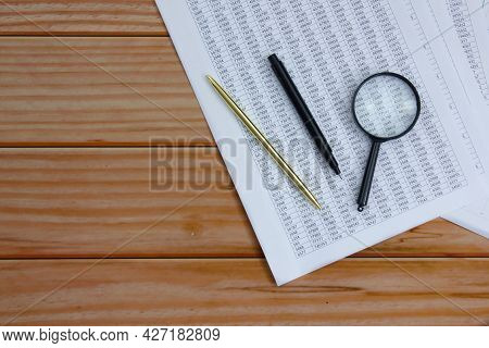 Financial Report Pen, Marker And Magnifier On Wooden Background. Copy Space. Background For Presenta