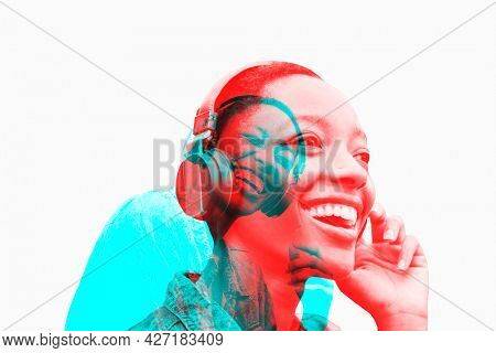 Woman listening to music with wireless headphones in double color exposure effect