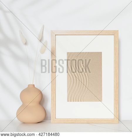 Wooden picture frame with zen sand photo on the wall interior concept