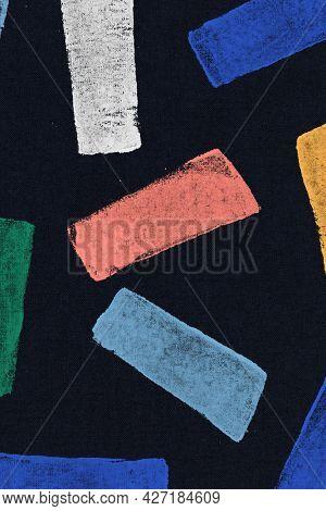 Colorful block print pattern on black background