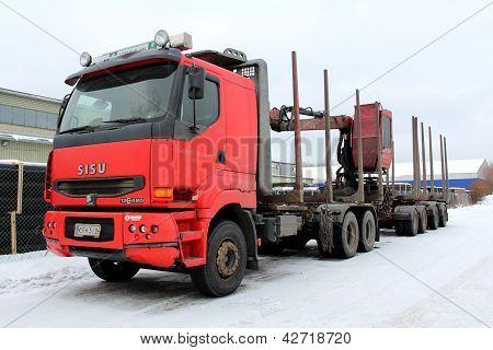 Red Unloaded Sisu Logging Truck