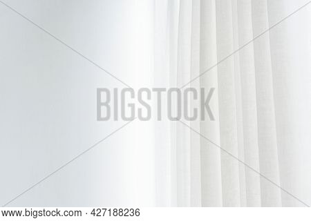 White pleated curtain in a living room