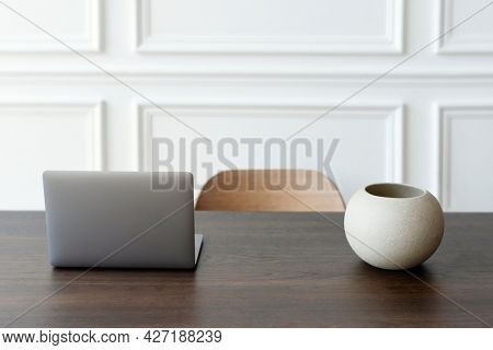 Minimal home office and workspace with laptop on the table