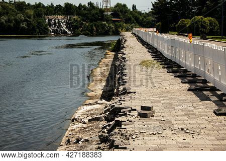 Erosion On The Banks Of The River. The Cliff Retaining Structure Collapsed Due To Erosion And Heavy