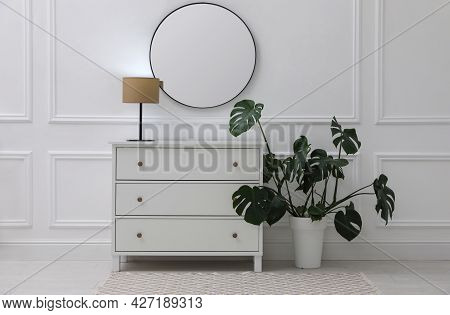 Light Hallway With Stylish Mirror And Chest Of Drawers. Interior Design