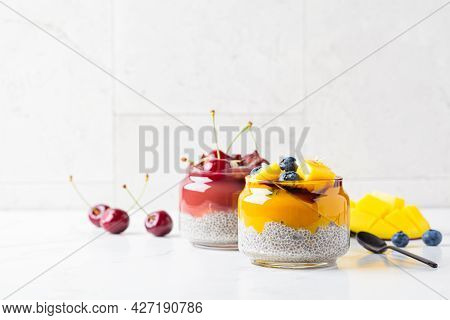 Chia Pudding With Fruit And Berry Smoothies In A Jar, Copy Space. Healthy Food Concept, Vegan Breakf