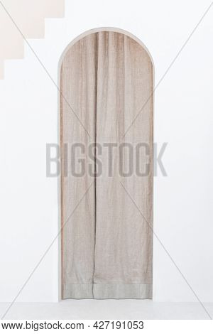 Brown curtain with an arched door