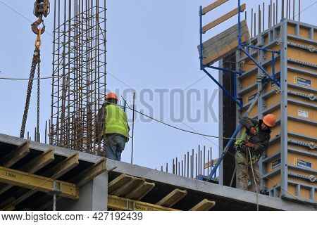 Kyiv Ukraine - March 16 2021:  A Group Of High-rise Assemblers Work On The Top Floor Of A Constructi