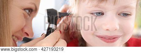 Otorhinolaryngologist Looking At Sore Ear Of Little Girl