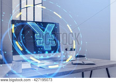Close Up Of Desktop In Office With Glowing Yen Interface, Computer Monitor And Other Icons. Currency