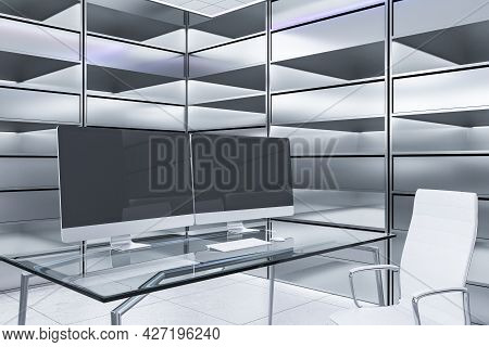 Abstract Futuristic Office Interior With Two Blank Black Computer Screens On Desk And Silver Bookcas