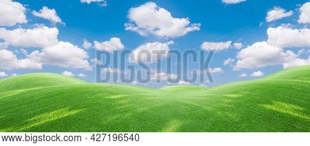 Panoramic View To Grass  And Blue Sky With Light Clouds,image Of Green Grass Field And Bright Blue S