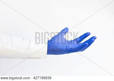 Doctor Wearing Blue Latex Glove. Opened Hand. White Background. Copy Space