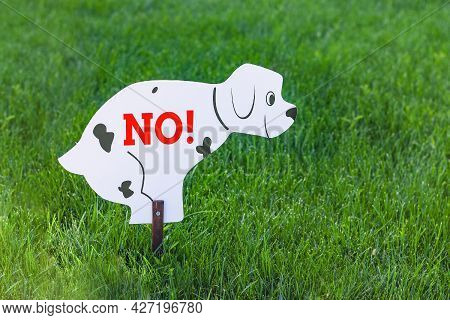 Dogs Are Not Allowed To Poop. A Sign In The Form Of A Dog That Sat Down To Go To The Toilet With The