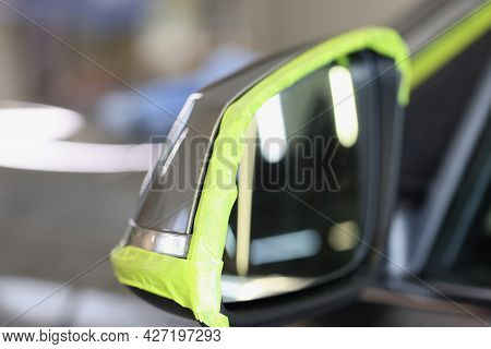 Side Car Mirror Has Green Protective Tape For Polishing Car