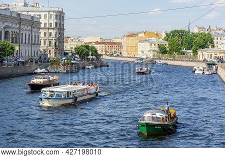 Saint Petersburg, Russia - July 2021: Cruise Boats Along Fontanka River In Summer