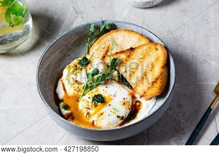 Cilbir Or Turkish Eggs. Dish Served As Mezze: Poached Eggs Topped Over Herbed Greek Yogurt, Then Dri