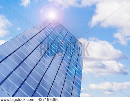 Modern Financial Real Estate Building For Business Corporation With Lens Flare. 3d Rendering