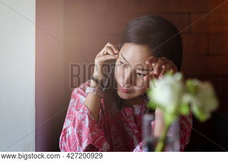 Serious Confident Beautiful Woman Talking On Mobile Phone